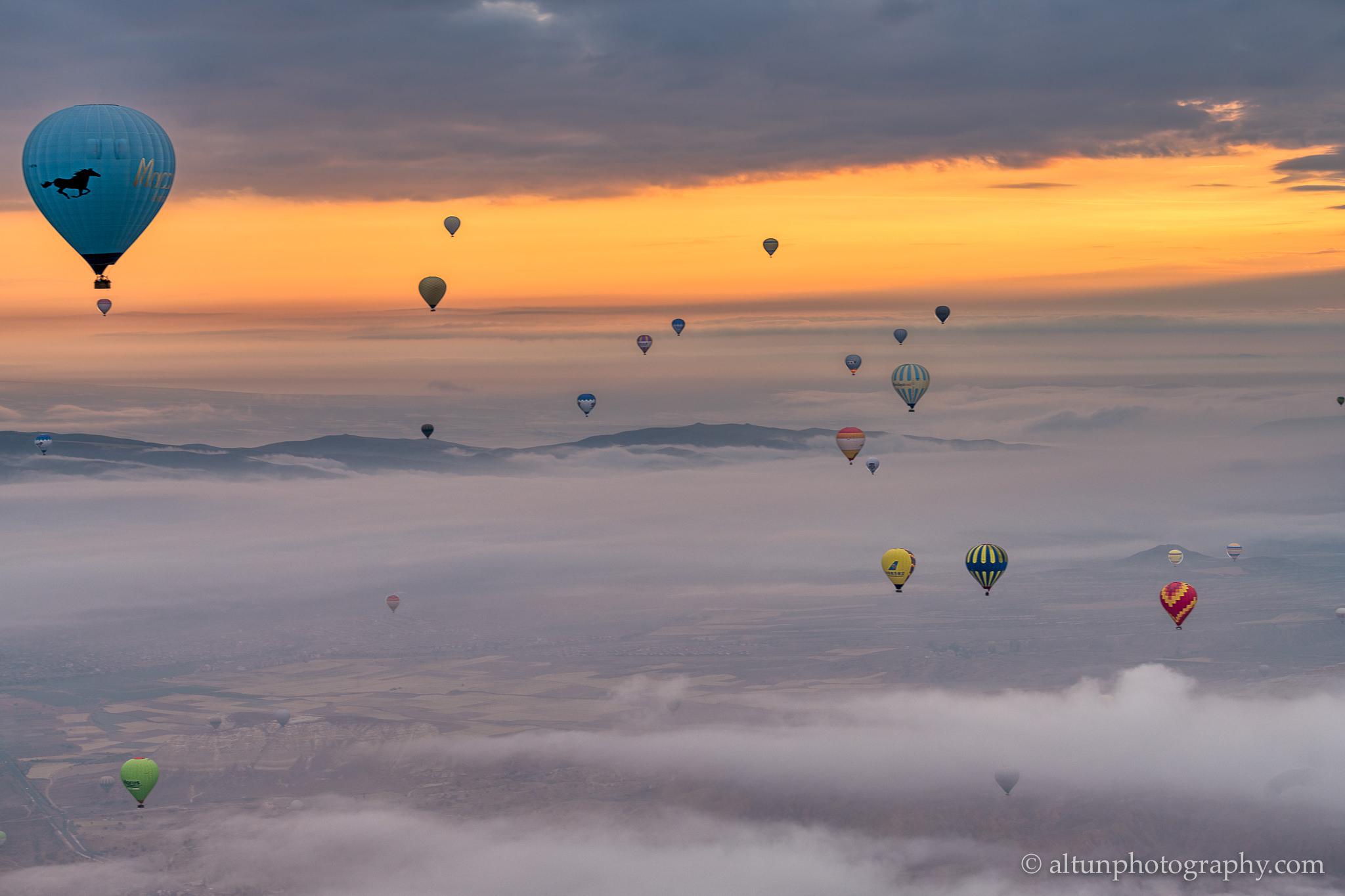 Cappadocia balloons over clouds